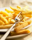 Fries on plate with fork