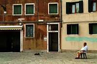Side profile of a man sitting in the courtyard of a building, Venice, Veneto, Italy