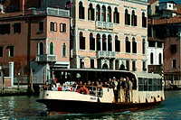 Tourboat in a canal, Venice, Veneto, Italy