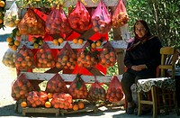 Portrait of a mature woman sitting at market stall, Crete, Greece