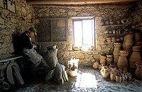 Side profile of a male potter making pottery, Crete, Greece
