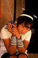 Close-up of a young woman listening to a radio, Thailand