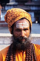 Nepal, Kathmandu, close-up of Hindu Holy man wearing orange turban, forehead painted with white stripes.