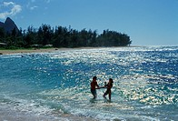 Couple in ocean, Hawaii