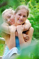 two teenage girls embracing