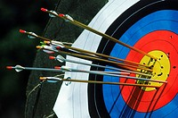 Arrows in or near the bulls eye of target during Olympic archery competition