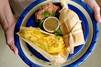 Vegetarian plate - cheese tamale and refried beans