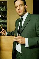 Cash, bar, businessman, whisky glass, Cigar, smiles, half portrait, broached   Business, managers, man, bar, gets along, smokes,  Cigar smokers, smoke...