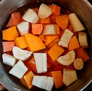 In the pot, parsnips, sweet potato, butternut squash and carrots