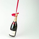 Swinging champagne bottle