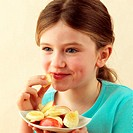 Child eating fresh fruit