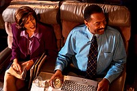 Business People on Airplane