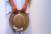 Woman Holding a Straw Hat