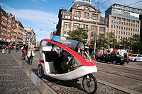 Taxi bike on Dam square in Amsterdam. Netherlands