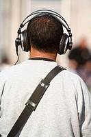 Tourist with headphones.