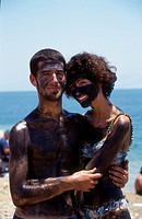 Couple Painted with Black Mud at Eingedi, Dead Sea, Israel