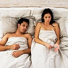Woman Taking Pills While Man Sleeps