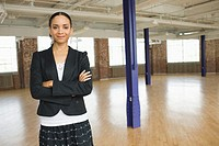 Businesswoman Standing in Empty Loft