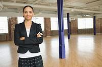 Businesswoman Standing in Empty Loft