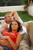 Couple Relaxing in Garden