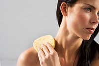 Woman Cleaning Neck with Sponge