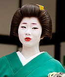 Geisha in traditional make-up and wearing a kimono in the Gion district of Kyoto, Japan