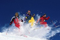 Three Skiers Jumping