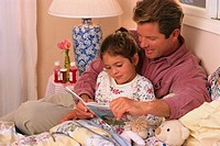 Father Reading to Sick Daughter