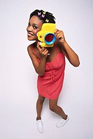 Young Woman Holding Toy Camera