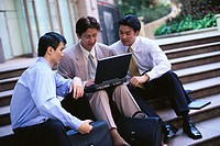 Businessmen Using a Laptop (thumbnail)