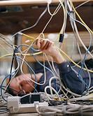 Man Connecting Computer Wires