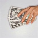 Hand Holding Paper Currency
