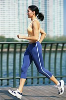Woman Jogging on Pier