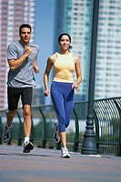 Couple Jogging on Pier
