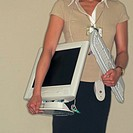 Woman Holding Computer Equipment (thumbnail)