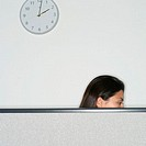 Woman Busy Working in Cubicle