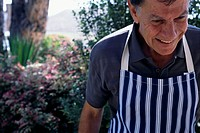 Man in Apron at Barbecue