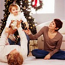Couple Playing with Baby on Christmas