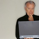 Pensive Man Using Laptop