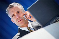 Businessman with Laptop and Cell Phone