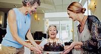 Senior Women with Birthday Cake