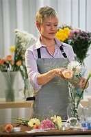 Smiling Florist Arranging Bouquet
