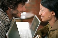 Young Couple with Laptops