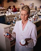 Pharmacist Comparing Drug Labels