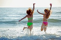 girl 13yrs, girl 18 yrs jumping in waves