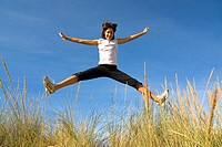 Young woman jumping (thumbnail)