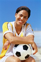 Female Sitting with Soccer Ball