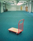 Red Trolley in Empty Room