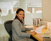 Businesswoman with Papers at Desk