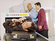Businessman Being Scanned at Airport